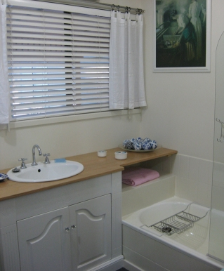 Bathroom basin and bath after renovation